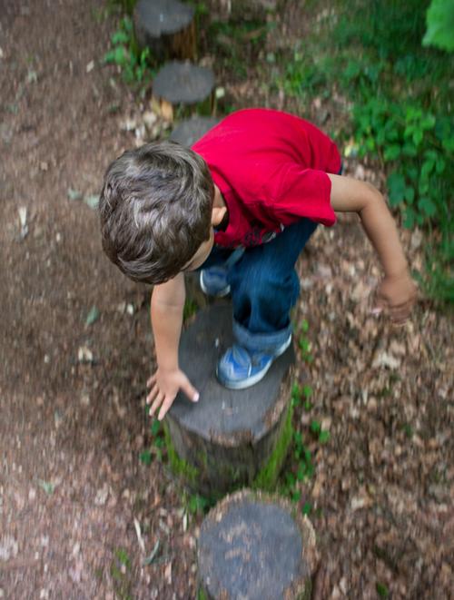 PoshLots - boy playing in forest